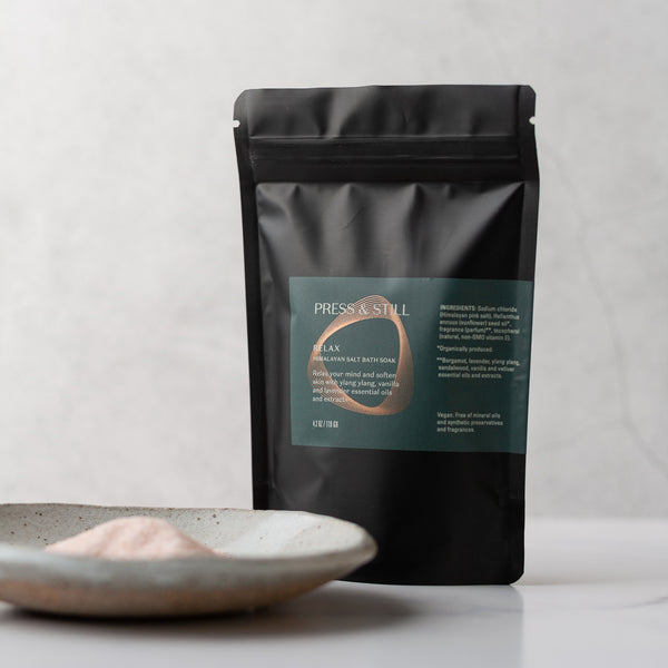 Relax bath soak made with Himalayan salt, sunflower seed oil and essential oils and extracts of lavender, ylang ylang, vanilla and sandalwood.