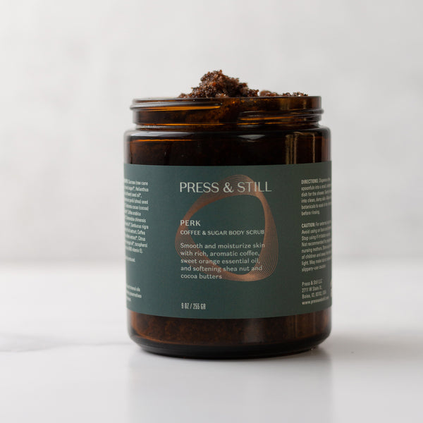 Perk body scrub made with sugar, coffee, shea butter, sunflower seed oil, jojoba, and coffee and sweet orange extracts.