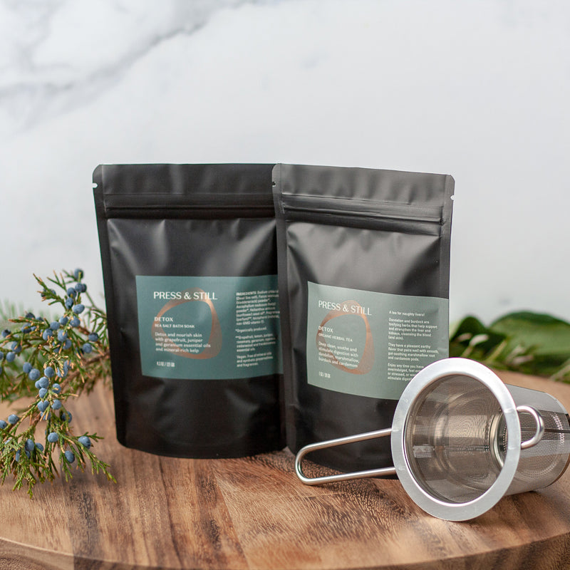 Detox gift set featuring Detox sea salt bath salts and organic herbal tea, and a stainless steel fine mesh infuser.