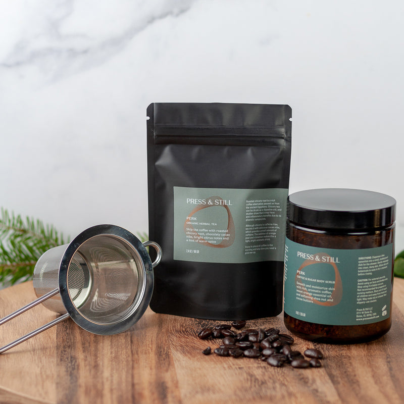 Perk gift set featuring mildly caffeinated organic tea, infuser, and sugar and coffee body scrub.