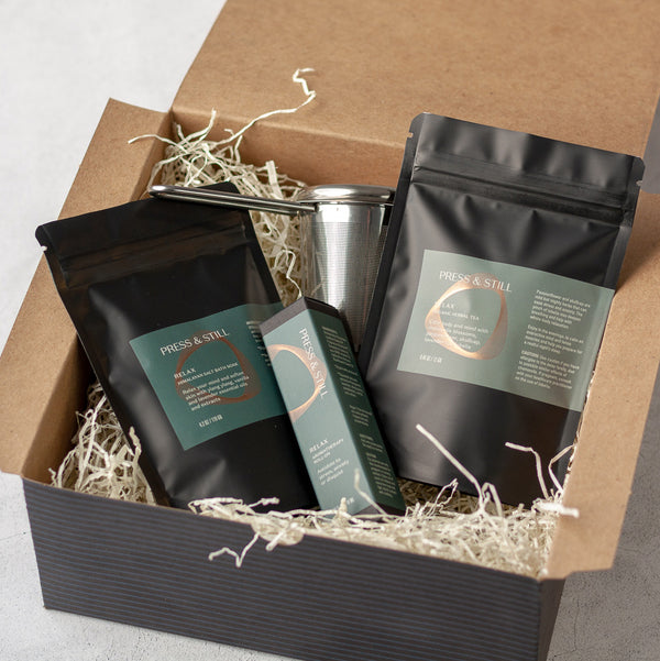 Relax gift set featuring Relax bath soak, organic herbal tea and a stainless steel fine mesh infuser (all in a box).