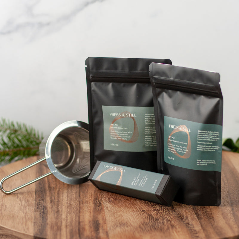 Relax gift set featuring Relax bath soak, organic herbal tea and a stainless steel fine mesh infuser.