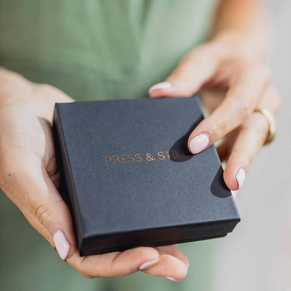 Press & Still aromatherapy exploration set featuring copper logo on matte black box.