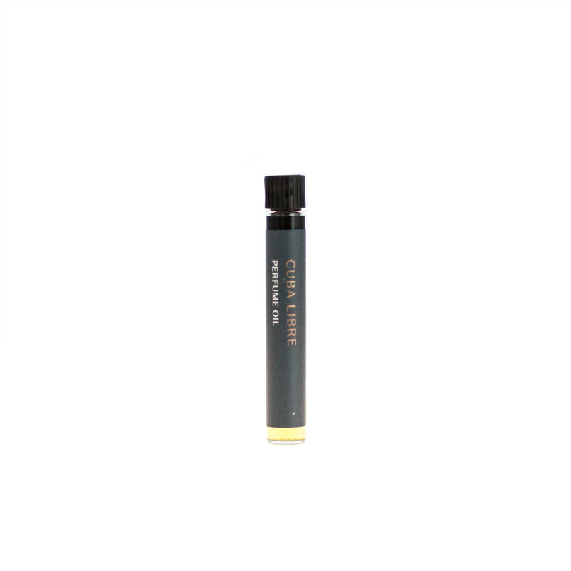 Cuba Libre botanical perfume oil (0.03 fl oz/1 ml). Organic jojoba exquisitely scented with refreshing lemon-lime citrus, sweet-spicy cinnamon and woody, tobacco-like vanilla essential oils and extracts.
