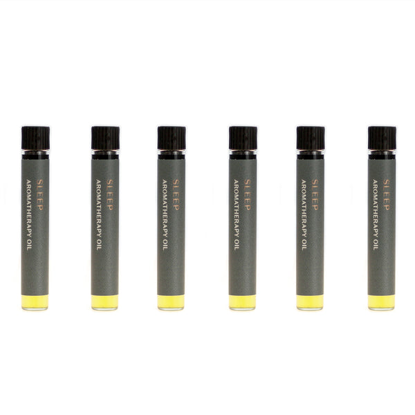 Case of six Sombrio botanical perfume oils (0.03 fl oz/1 ml). Organic jojoba exquisitely scented with fresh fir, musky spruce, smoky guaiacwood and leathery oud essential oils.