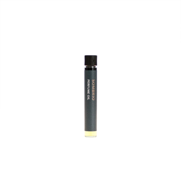 Sombrio botanical perfume oil (0.03 fl oz/1 ml). Organic jojoba exquisitely scented with fresh fir, musky spruce, smoky guaiacwood and leathery oud essential oils.