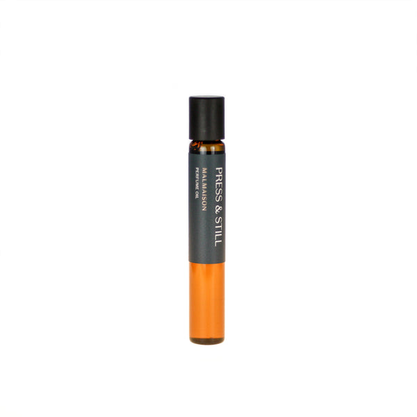Malmaison botanical perfume oil (0.33 fl oz/10 ml). Organic jojoba exquisitely scented with intense rose, geranium, jasmine, floral mandarin and sweet, woody zdravetz essential oils and extracts.