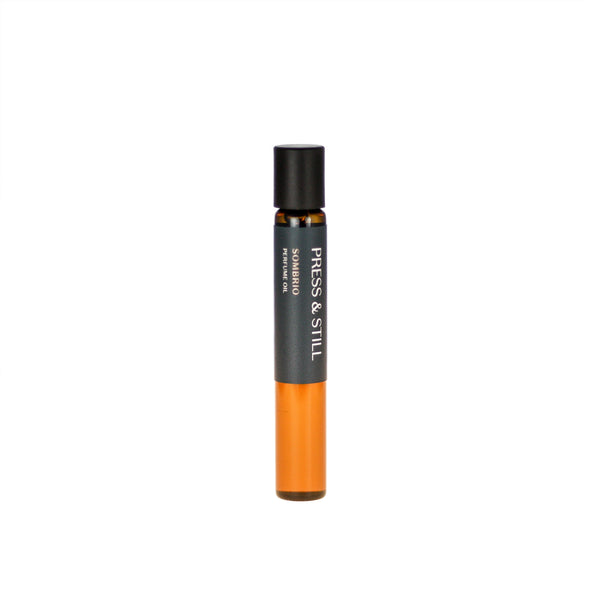 Sombrio botanical perfume oil (0.33 fl oz/10 ml). Organic jojoba exquisitely scented with fresh fir, musky spruce, smoky guaiacwood and leathery oud essential oils.