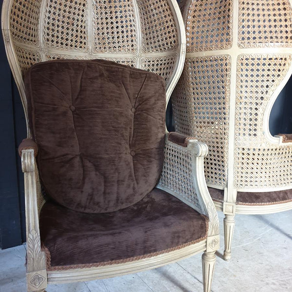 A Pair Of Caned Porters Chairs
