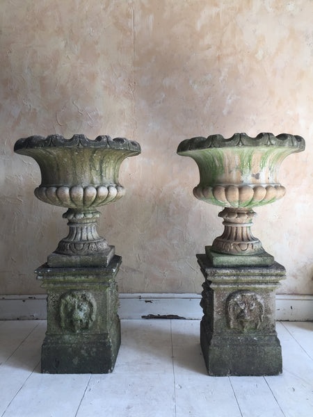 Pair Of Urns On Pedestals