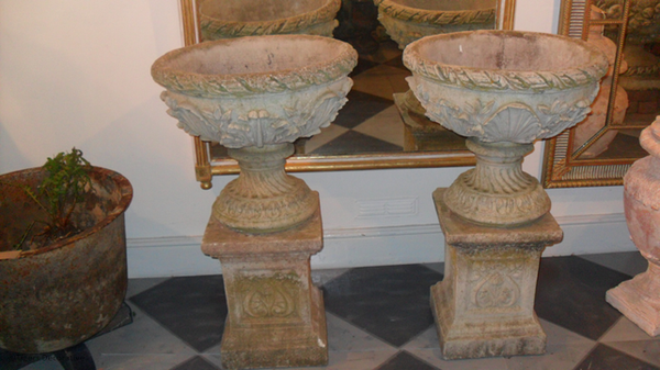 Pair Of 20th Century Composite Stone Urns On Columns