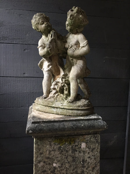 Statue Of Children On Plinth
