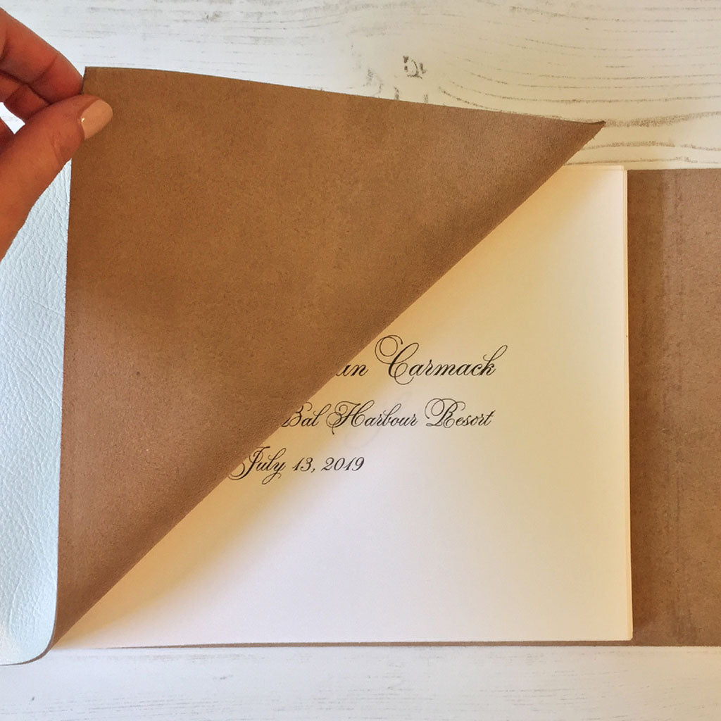 Personalised Wedding Guest Book handmade in leather, turning the page