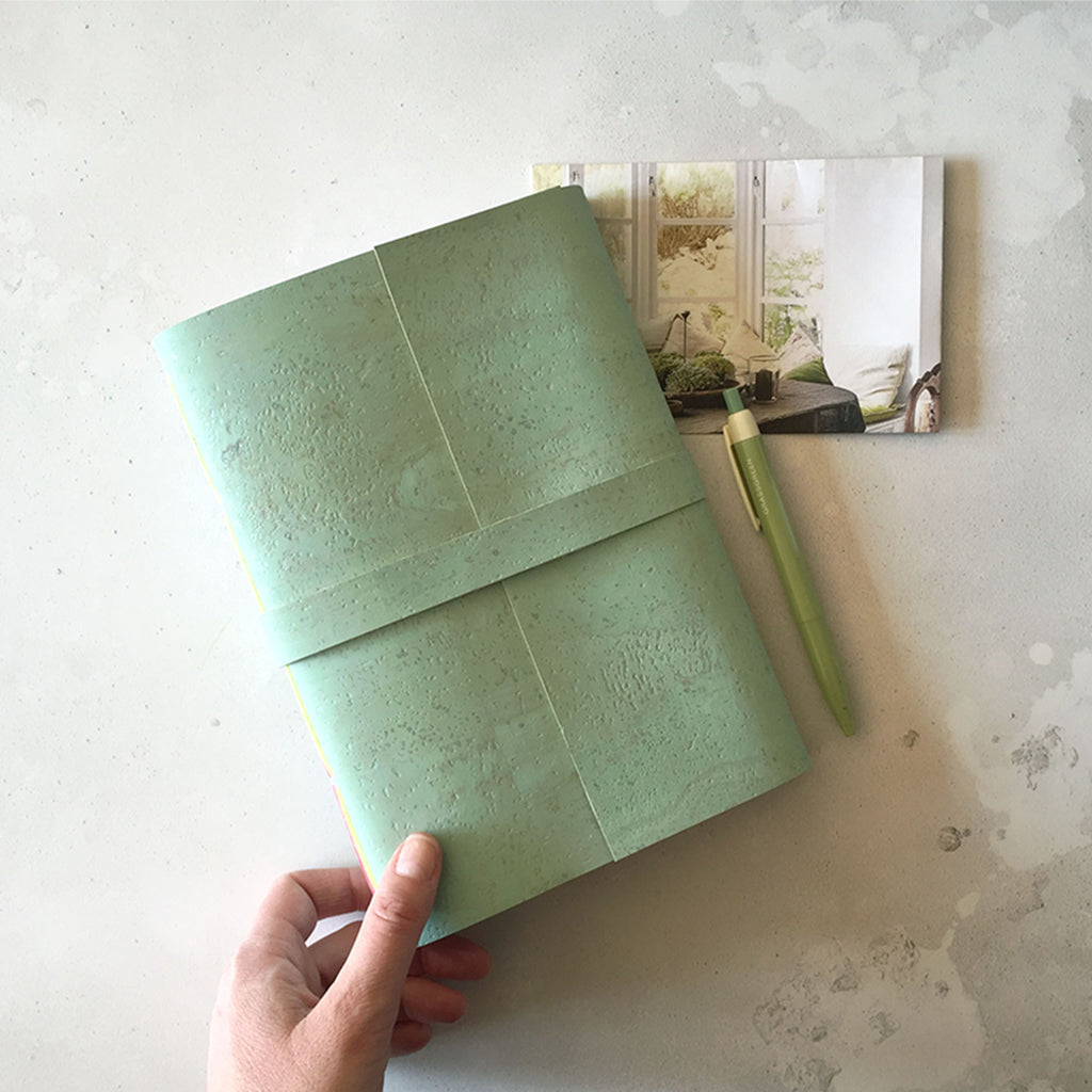 Cork Vegan Journal: Mint Green sustainable notebook shown with pen and envelope.