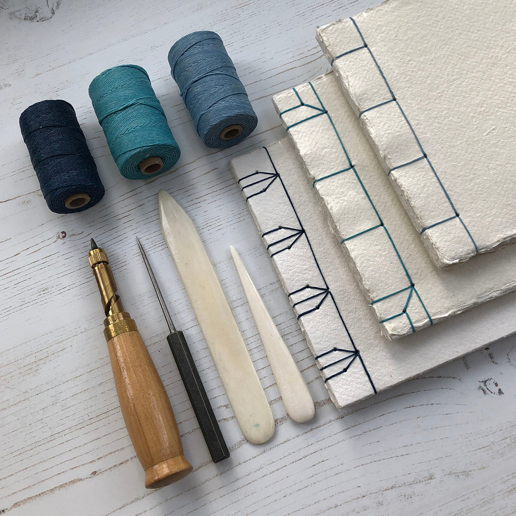 Stab Stitch Sketchbooks stitched in blue linen thread