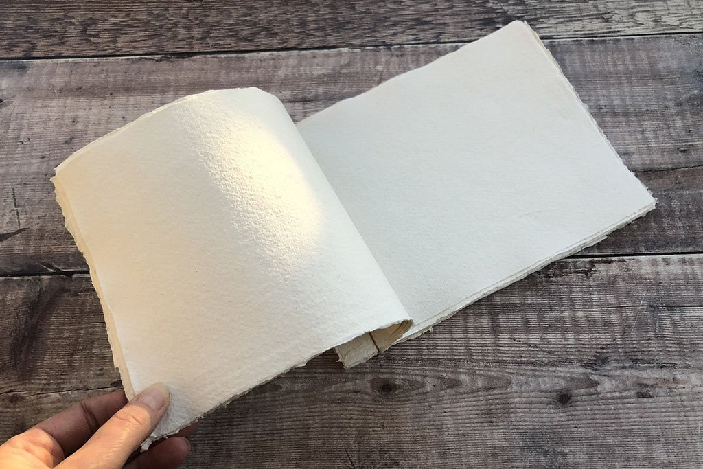 Japanese Stab Stitch Sketchbook held open, showing cotton rag khadi paper pages