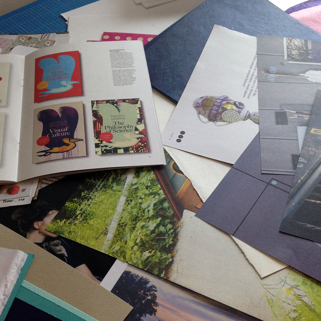 Choosing repurposed papers from old magazines and books.