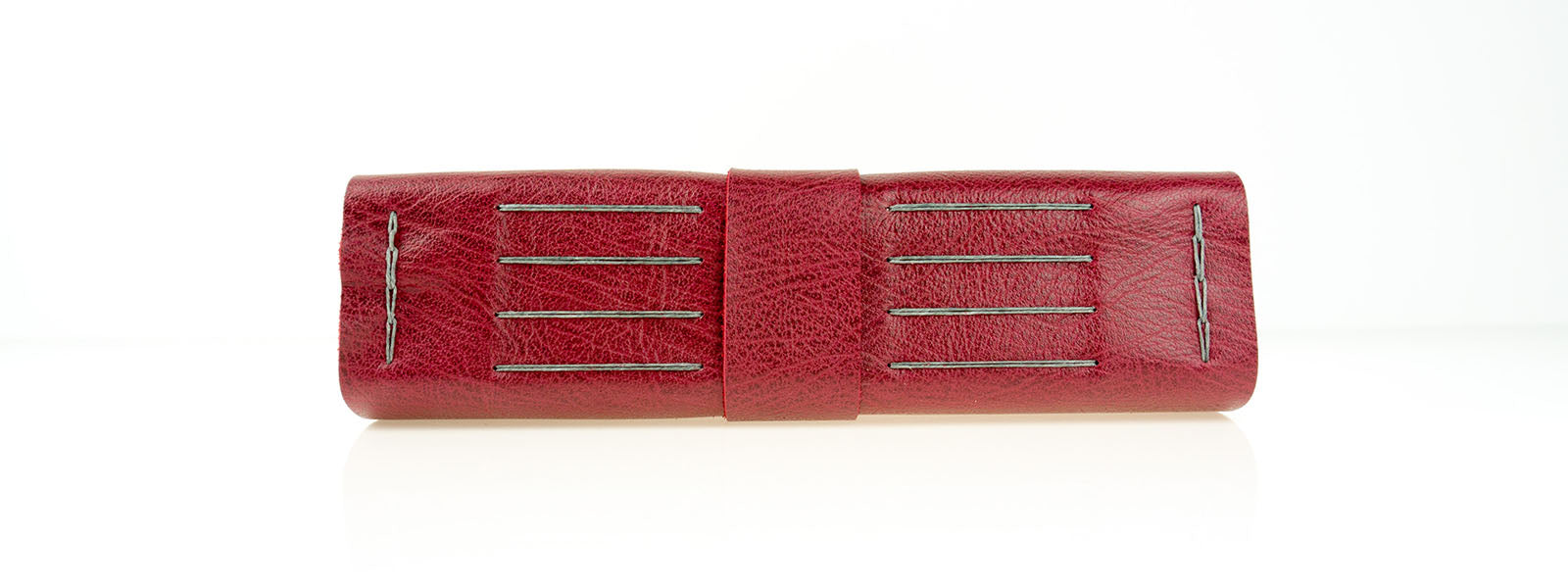A4 Leather Memory Book spine, bound by hand in Crimson and Grey