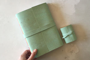 Handmade Mint Green A5 Sketchbook with Miniature Journal in Mint Green vegan cork textile to show size.
