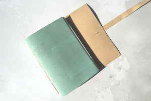 Softcover Sketchbook partially open showing inner surface of cork textile