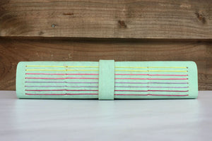 Multicoloured longstitch spine stitching on a handmade vegan cork sketchbook
