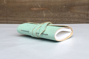 Grey stitching along spine of Mint Green Cork Vegan Mini Journal