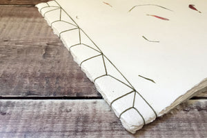 Sketchbook in Japanese Hemp Leaf binding stitched in Olive linen thread.