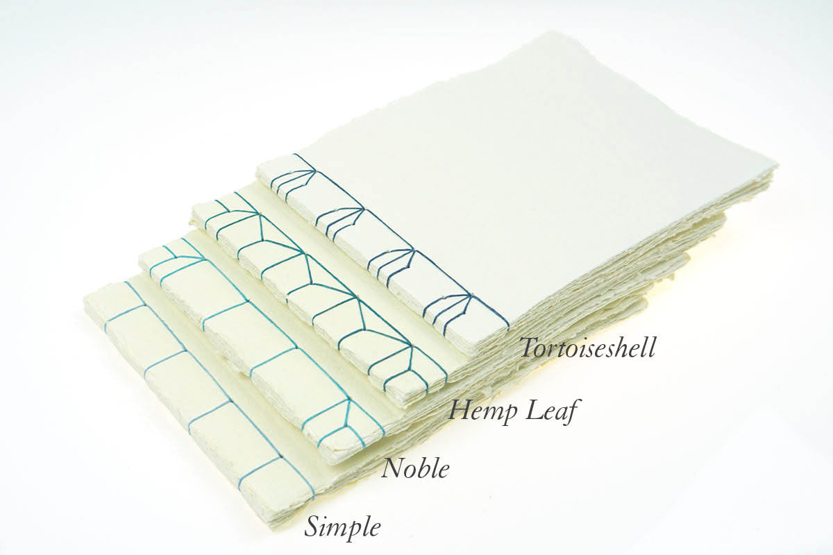 Japanese Stab Stitch Sketchbooks bound in cotton rag handmade khadi paper.