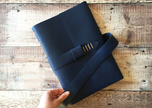Blue Leather Memory, Book A4 portrait size with strap option.