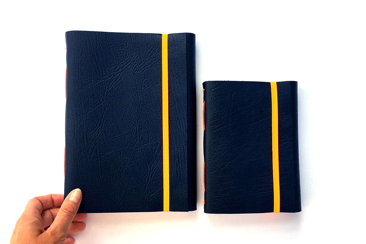 A5, A6 Leather Sketchbooks in Navy Blue and Orange with elastic