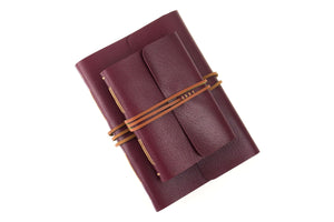 Premium Quality Leather Bound Journals or Notebooks in Maroon with Tan details and marbled endpapers. A5 and A6 size ship worldwide.