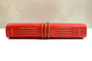 Spine of Longstitch with Linkstitch red leather bound notebook