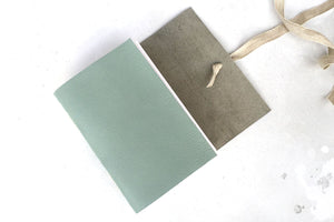 Softcover leather bound sketchbook handmade in the UK, Duck Egg and Linen, A6 size.