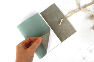 Hand turns softcover leather sketchbook bound by hand in Duck Egg with cartridge paper