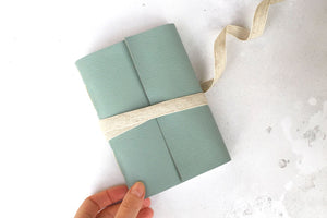 A6 small Leather Sketchbook or Notebook with linen ribbon, bound in Duck Egg Longstitch style.