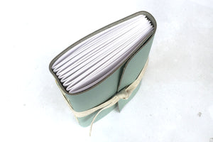 Leather Sketchbook or Notebook with hand stitched pages, bound in leather with linen ribbon.