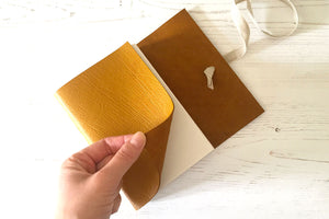 Yellow A6 Leather Sketchbook handmade in the UK with linen ribbon