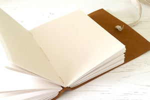 A6 Leather Sketchbook with recycled cartridge paper pages, bound by hand Longstitch style.