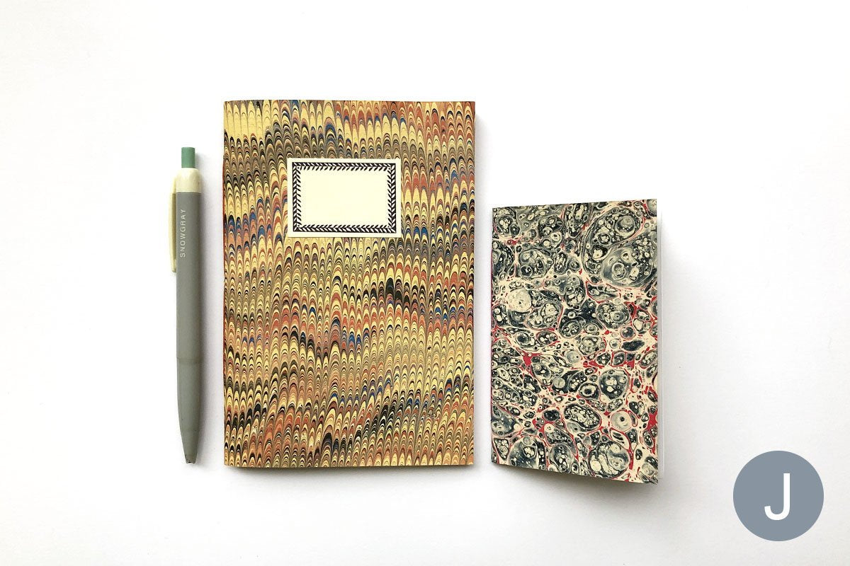 Variety of 'Small' Marbled Notebook Gift Sets: A6 and A7 paperback journals and slim jotters.