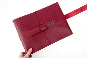 Handmade Memory Book in Crimson leather with strap to close