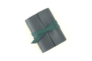 Grey Mini Leather Notebook with Teal details.