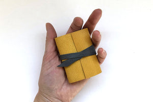 Mini Leather Journals fit in the palm of your hand.