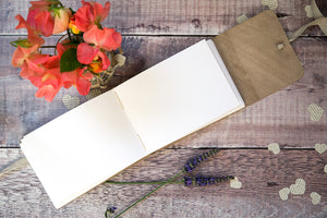 Hand sewn pages lie open to receive your guests' well wishes in this leather Wedding Guest Book