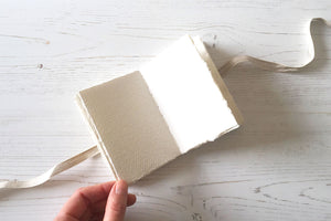 X Small Wabi Sabi pocket sketchbook with cotton rag paper, hand stitched in linen with ribbon to close.