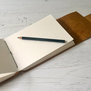 A6 Leather Sketchbook with 300gsm cold pressed watercolour paper for artists.