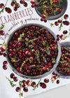 Beautiful kitchen towel printed with dishes with fresh cut cranberries