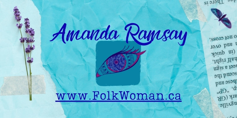 """A wrinkled aqua paper background contains layers of other papers including some with writing as if appearing torn from a book. On the left, Lavender is taped. Featured in the centre of the image is the name Amanda Ramsay, the folkwoman eye logo and the address hyperlinked to the website """"Folkwoman.ca"""""""