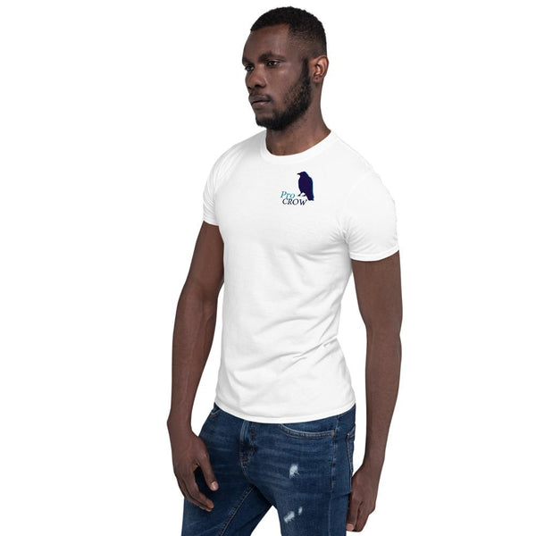 A black male-appearing model wears a white tee shirt with the design Pro Crow on it. He appears relaxed. The man is also wearing denim jean pants. He looks and is postured toward the left..