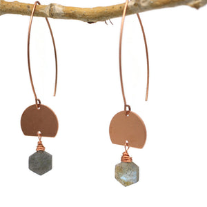 Grey Blue Labradorite beads in hexagon shape hang below half moon shaped copper sheet. Hang from long bunny ear shaped earwire. Earrings on tree branch