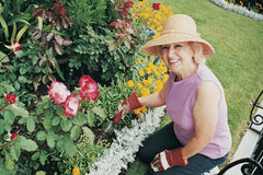 Woman gardening with On the Go Pouch
